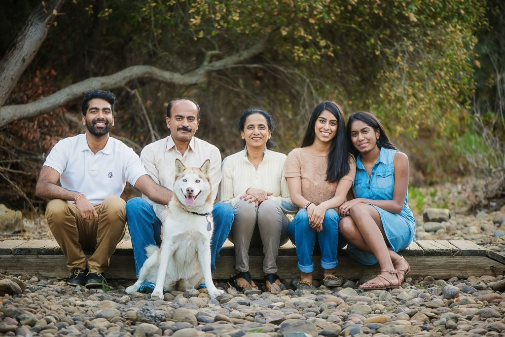 Family sitting together with Dog