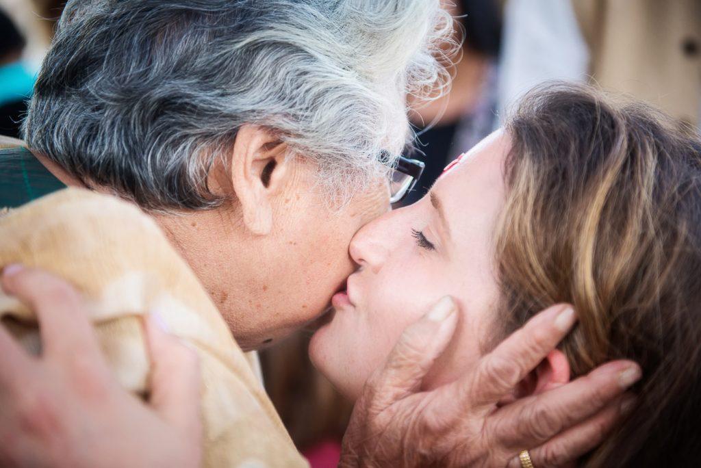 Bride kissing grandmother at Mehndi