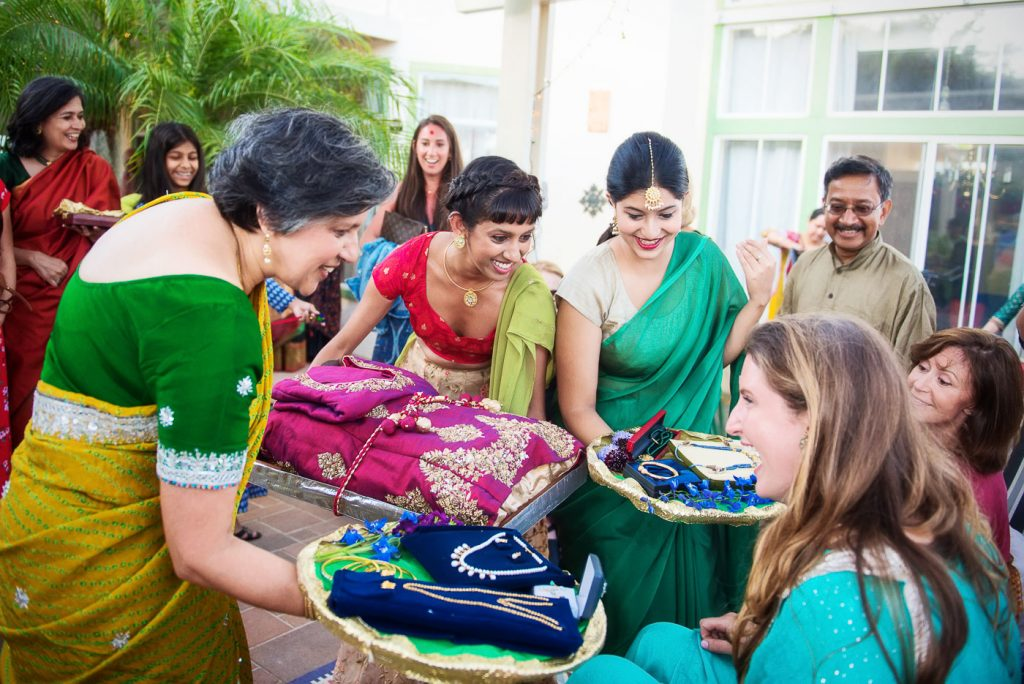 Bride receiving gifts from in laws at Mehndi