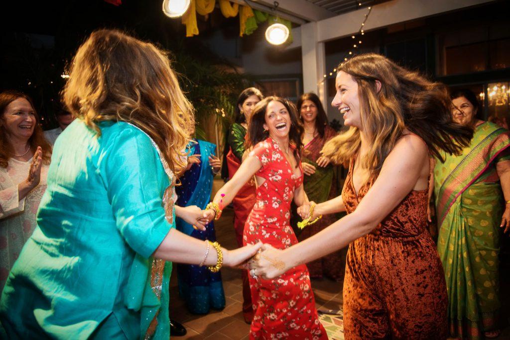 Bride dancing with bridesmaids at Mehndi