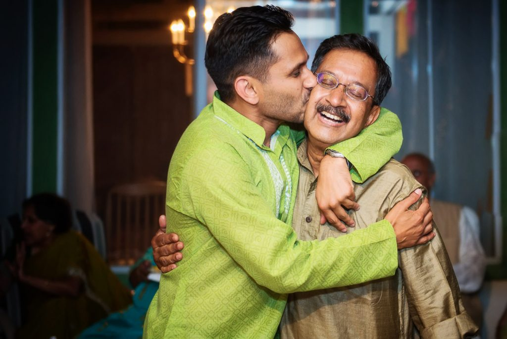 Groom kissing father at Mehndi Event