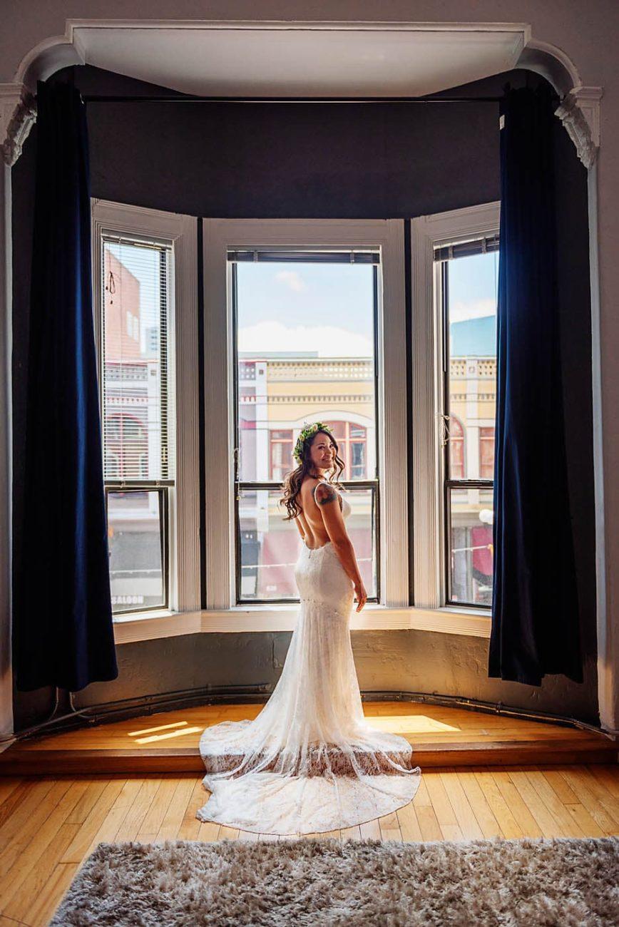 Bride posing I. her wedding dress
