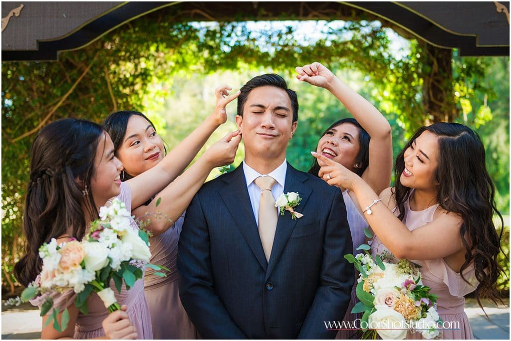 Fun photo of groom with Bridesmaid