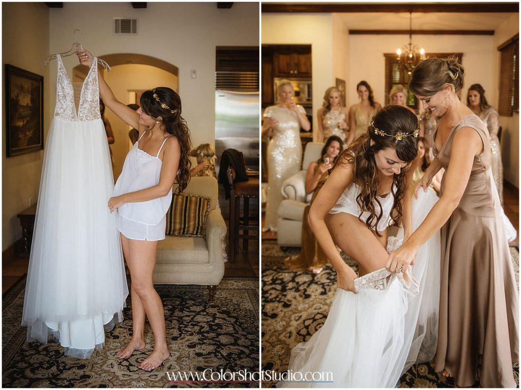 Bride getting into the dress Omni la costa resort wedding photography by color shot studio