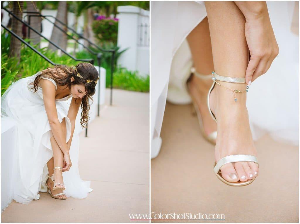 Bride putting on her shoes Omni la costa resort wedding photography by color shot studio