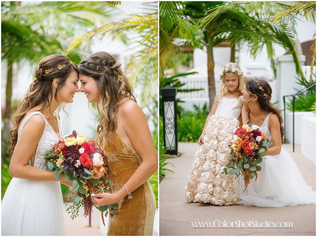 Bride posing with her maid of honor and flower girl