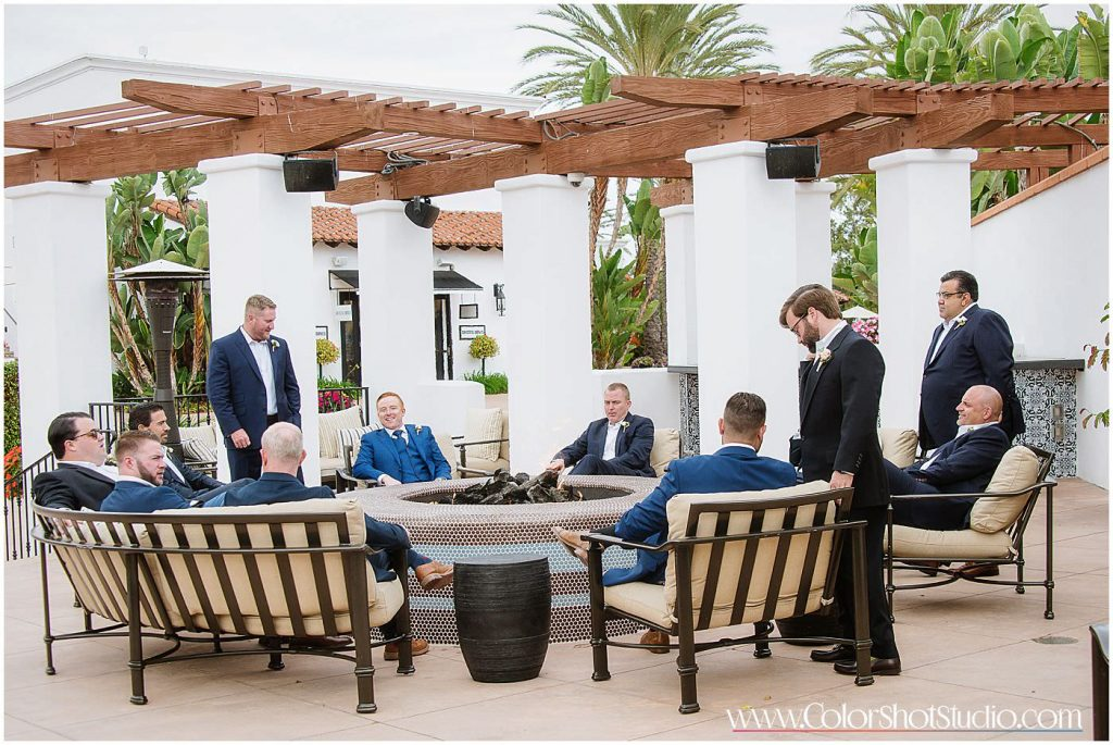Groom with groomsmen sitting together