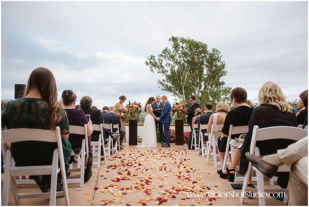 Bride and groom at the ceremony Omni la costa resort wedding photography by color shot studio