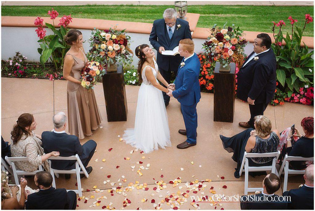 Bride smiling during the ceremony Omni la costa resort wedding photography by color shot studio