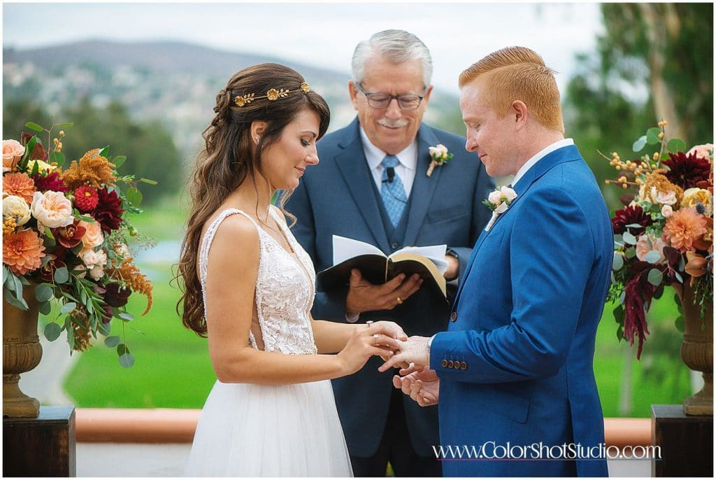 Bride and groom ring exchange during wedding ceremony
