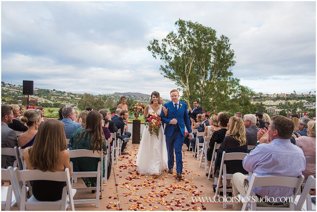 Bride and groom walking together as husband and wife