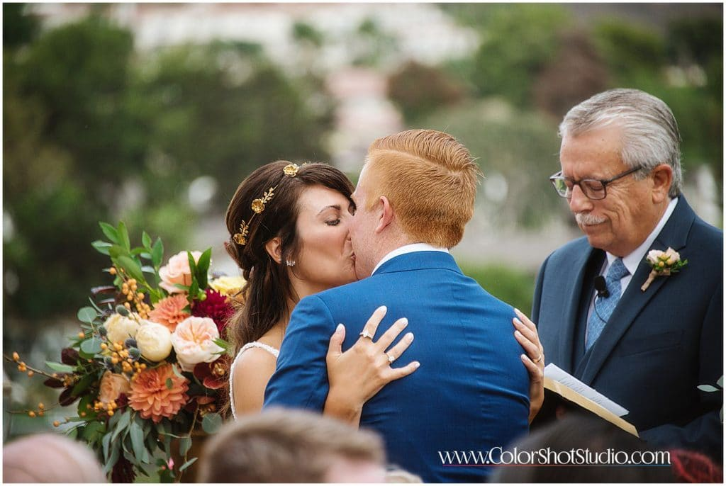The first kiss Omni la costa resort wedding photography by color shot studio