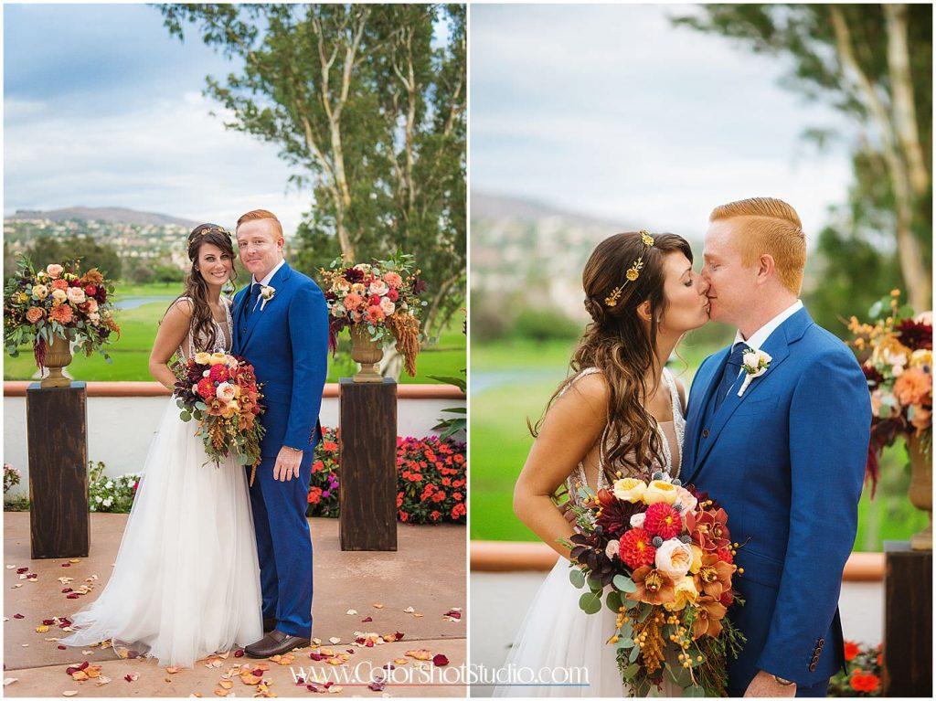 Bride and groom posing near the altar