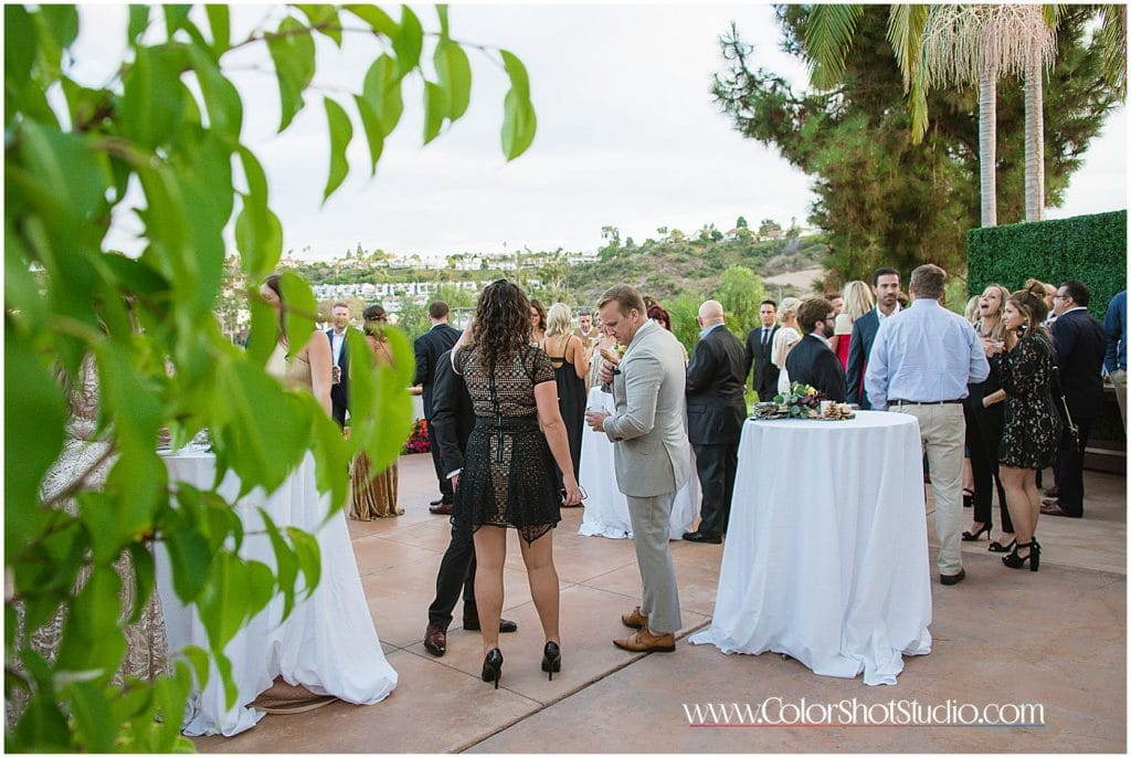 Wedding guests during cocktail hour Omni la costa resort wedding photography by color shot studio