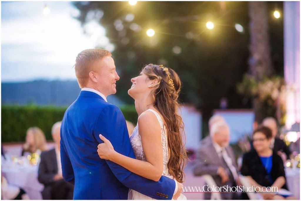 Bride and Groom enjoying first dance Omni la costa resort wedding photography by color shot studio
