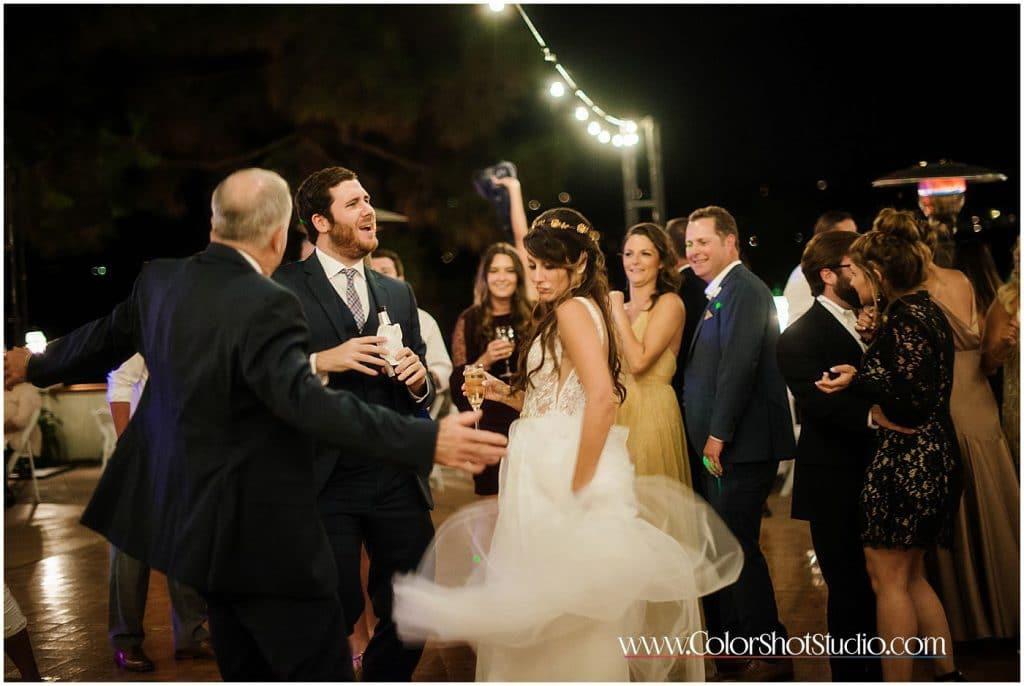 Bride dancing during her reception Omni la costa resort wedding photography by color shot studio