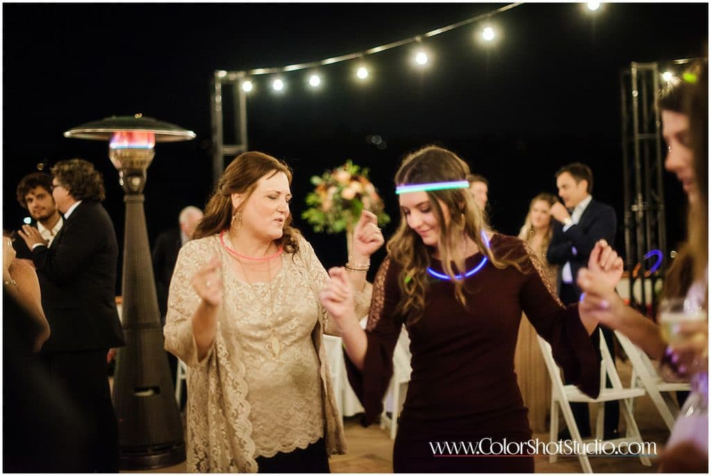 Brides mother dancing on the dance floor during wedding redception