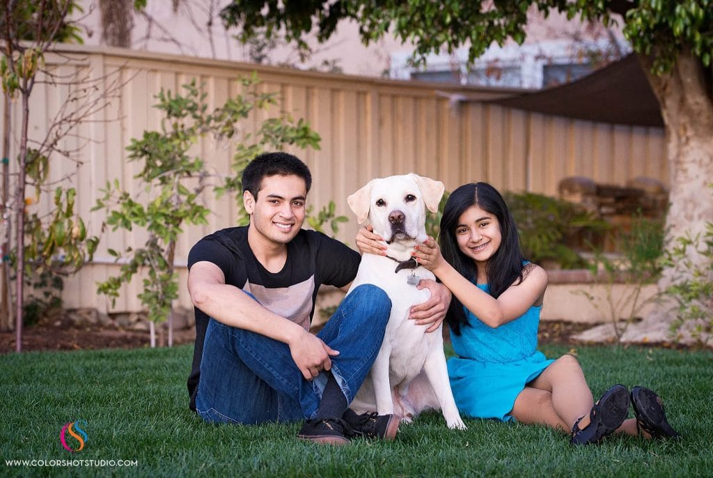 brother sister with their dog