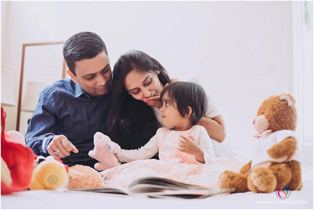 family of three book reading