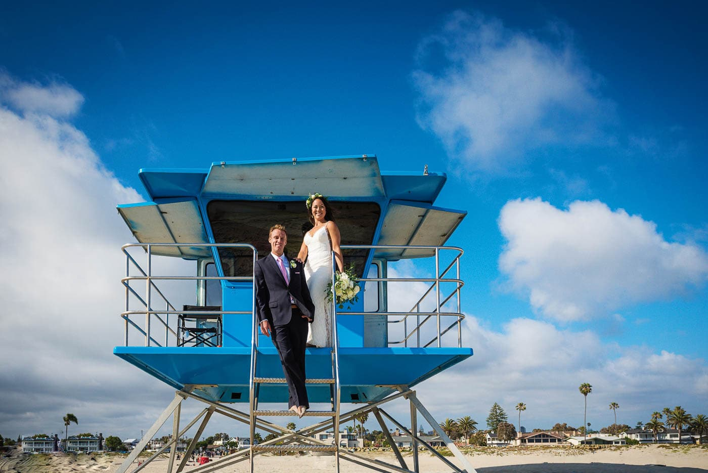 Bride and groom portrait at lifeguard tower